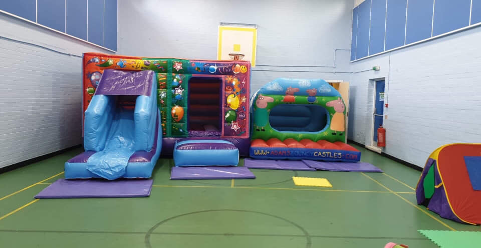 Inflatable bouncy castles in the sports hall