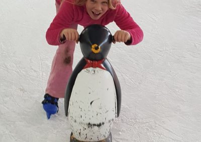 A young person enjoying time skating on the ice